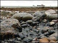 Oil on a beach near the MSC Napoli