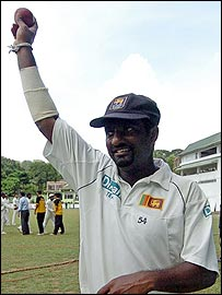 Muttiah Muralitharan celebrates his 700th Test wicket