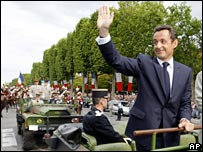 French President Nicolas Sarkozy takes part in Bastille Day parade