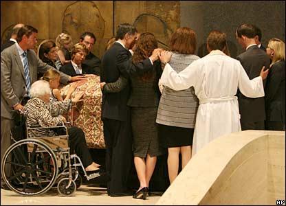 Family members gather around Lady Bird Johnson's coffin