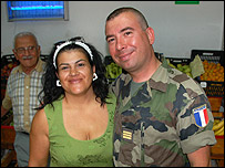Capt Arnaud Rudelle hugged by an inhabitant of Ayn Ebl, South Lebanon