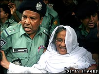 Sheikh Hasina outside court