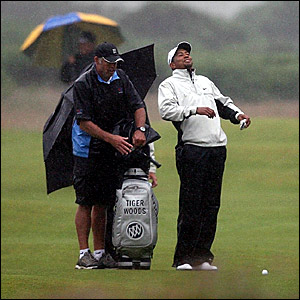 Tiger Woods braves the weather during a practice round at Carnoustie