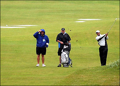 Tiger Woods (right) practices at Carnoustie