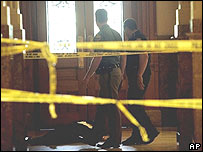 Police look over the body of a man at the Capitol in Denver