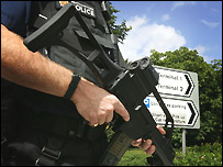 An armed police officer outside Heathrow Airport