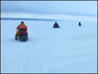 Riding snowmobiles on the ice. Image: BBC