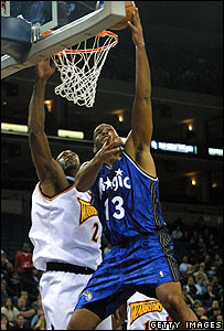 John Amaechi (right) playing for Orlando Magic
