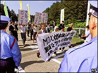 Anti-nuclear demonstrators march outside Tokyo Electric Power Co. 1999