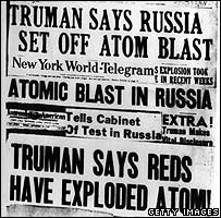 Headlines in New York papers announcing that Moscow has exploded an atomic bomb