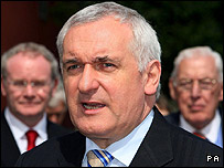 Bertie Ahern flanked by Martin McGuinness and Ian Paisley