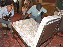 Workmen set up camp beds in the Senate building