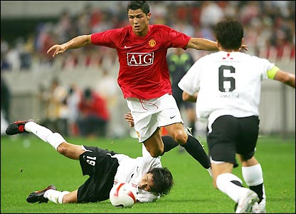 Ronaldo beats one of Urawa's defenders with a trademark run