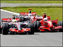 The McLarens of Lewis Hamilton and Fernando Alonso sandwich Kimi Raikkonen's Ferrari at the British Grand Prix