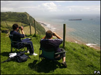 Napoli watchers on Devon cliffs