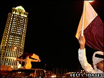 Boy waving flag in Doha, capital of Qatar
