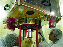 SSTL engineers work on the NigeriaSat-1 satellite that participates in the Disaster Monitoring Constellation (DMC)