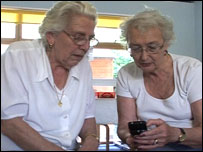 Pensioners looking at phone