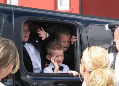 Boys looking out of limo window