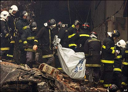 Firefighters remove bodies from the crash site