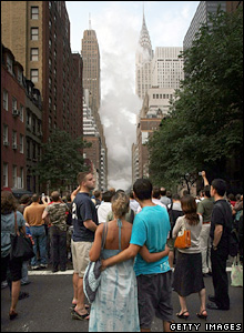 New Yorkers look at the steam rising near the Chrysler Building