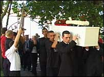 Jamie Clapp's coffin being carried into the church