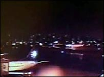 Still from video showing plane landing