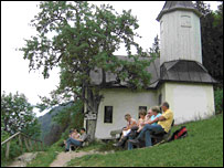 Hikers relax near chapel