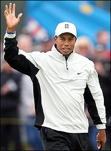 Woods celebrates his eagle at the 6th