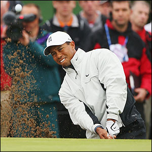 Woods splashes out of a bunker