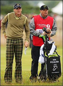 England's Ian Poulter chats with his caddie