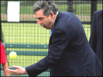 Gordon Brown playing tennis