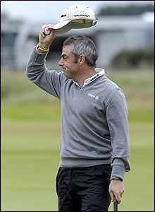 McGinley acknowledges the crowd at Carnoustie