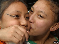 Sajani Shakya (L) is kissed by her elder sister Salini