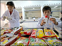 Chinese lab technicians test food samples - 12/06/07