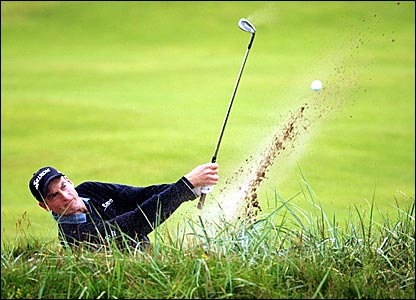 America's Jim Furyk plays out of a bunker on the second hole
