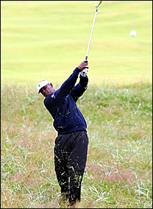 Vijay Singh hits out the rough