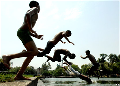 Children jump into a pool in central Budapest, Hungary