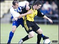 Ryan Russell holds off Kilmarnock's Rhian Dodds