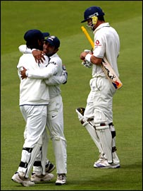 Wicket-keeper Mahendra Dhoni celebrates as Kevin Pietersen walks off prematurely