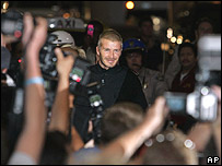 David Beckham is mobed by paparazzi as he arrives at LA airport