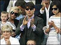 Victoria Beckham with Tom Cruise and his wife Katie Holmes at a Real Madrid match