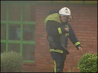 A firefighter rescues a school child in Worcester