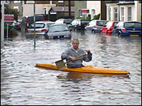 Man canoes down street in South Croydon. Pic: James Murray