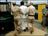 A Guantanamo detainee is escorted by US military personnel at Guantanamo Bay  (file photo)