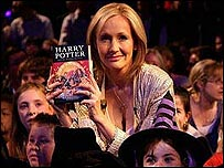 JK Rowling holds a copy of her final Harry Potter novel