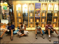 Young Harry Potter fans sitting reading