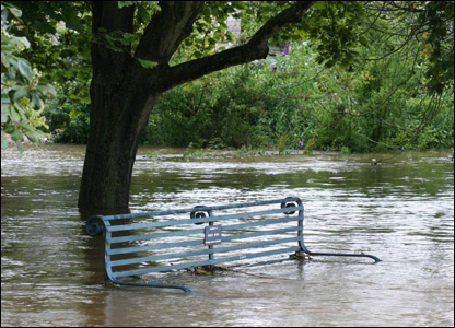 Flooded park bench in Crudwell