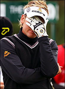 Ian Poulter reacts after a poor tee shot on 15