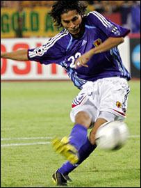 Japan defender Yuji Nakazawa scores the winning penalty